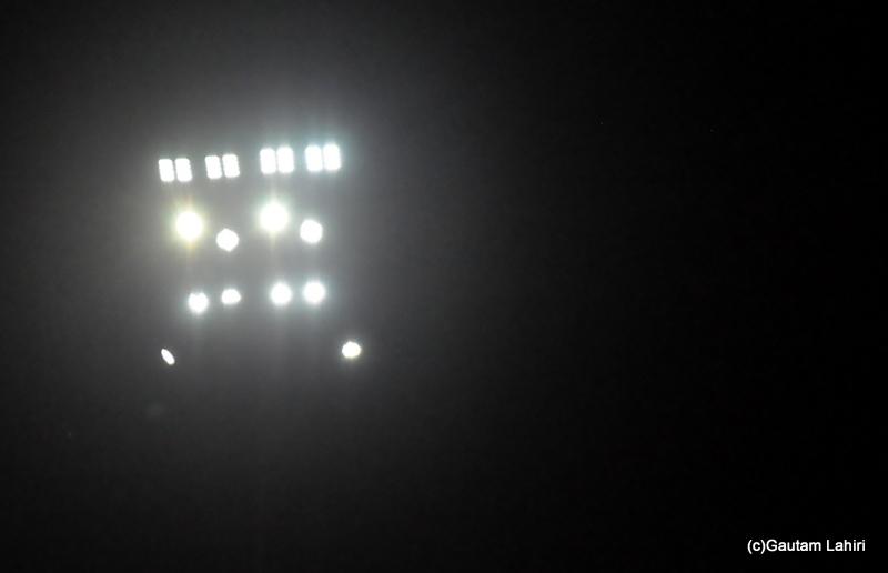 Flood lights of a cricker ground by Gautam Lahiri