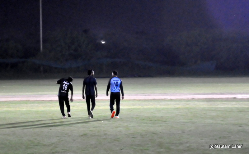 Cricket fielders on the ground by Gautam Lahiri