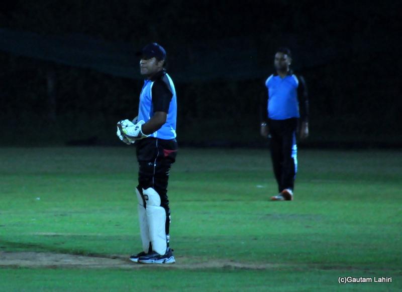 Wicket keeper looks on by Gautam Lahiri