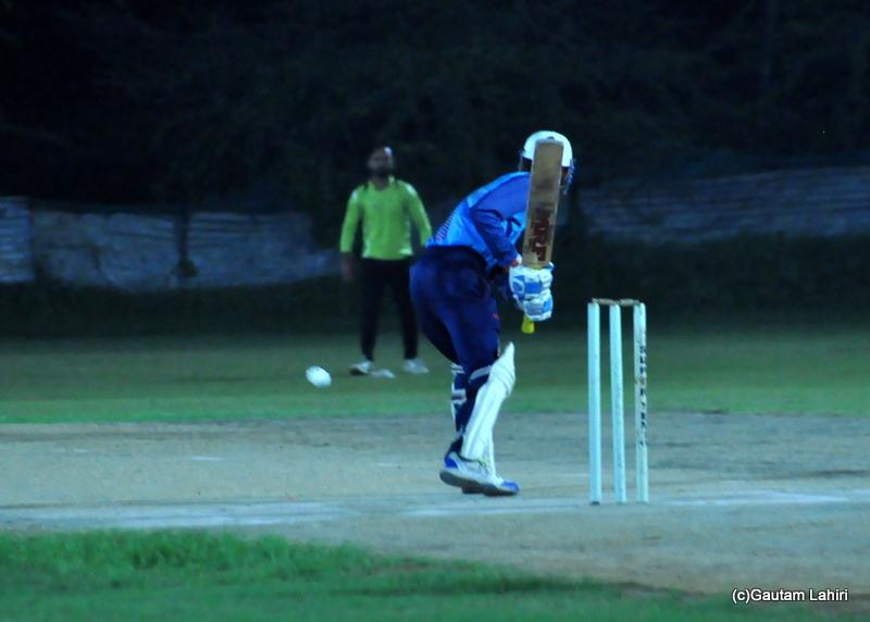 Cricket batsman lunges for a shot by Gautam Lahiri