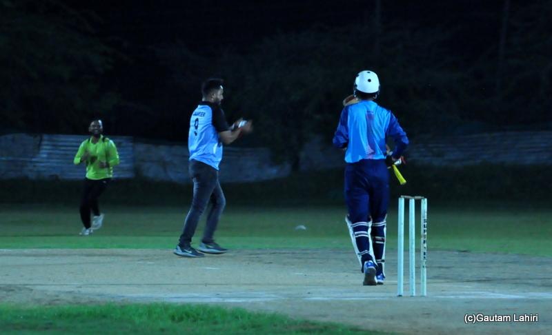The bowler catches the ball by Gautam Lahiri