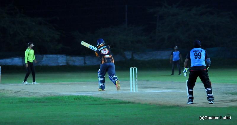 A cricket batsman hits four run by Gautam Lahiri