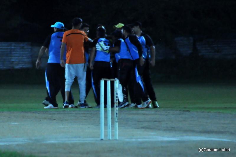 Cricket fielders jump with joy as a wicket falls by Gautam Lahiri