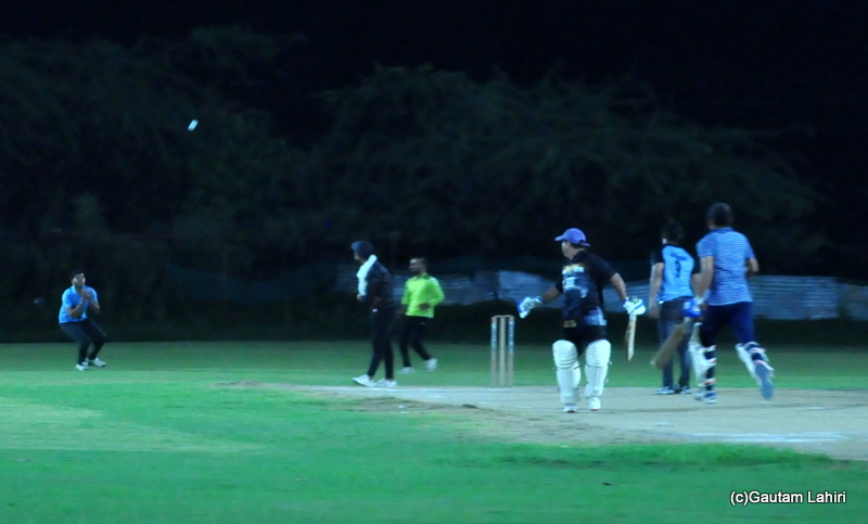 Cricket batsman lifts the ball, as it is about to get caught by Gautam Lahiri