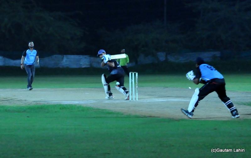 A cricket batsman pulls a shot by Gautam Lahiri