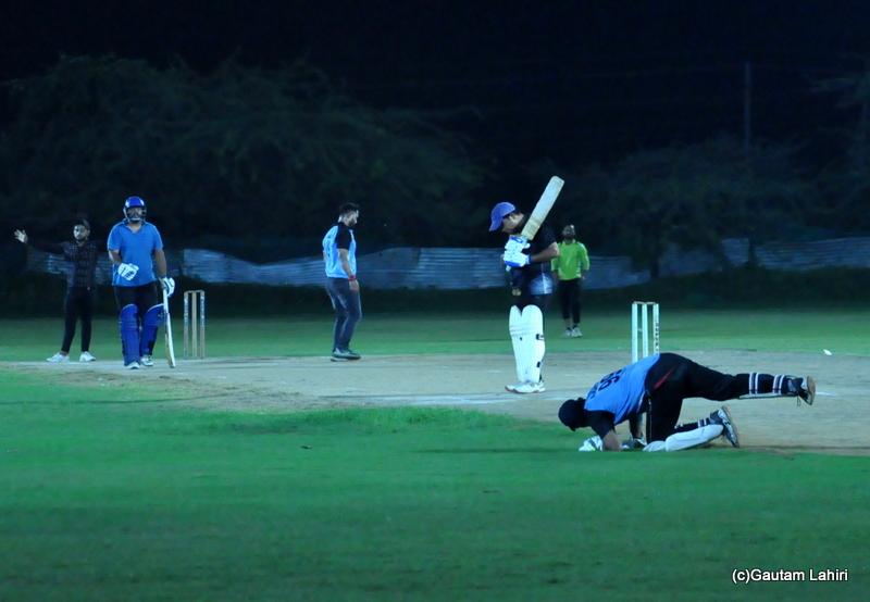 The cricket wicket keeper stops the rushing ball by Gautam Lahiri
