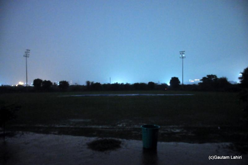 The cricket field aglow with city lights by Gautam Lahiri
