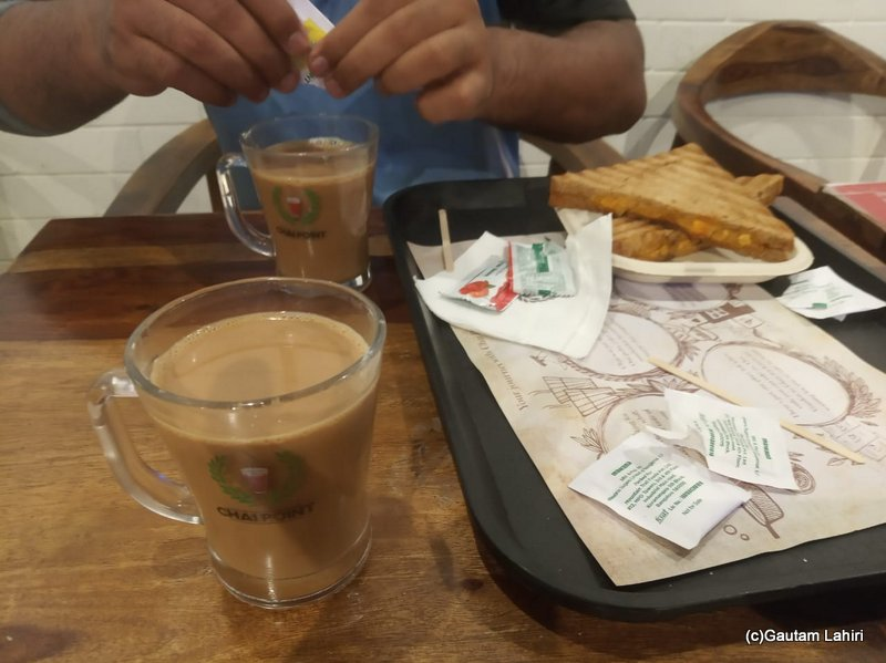 Having steaming hot ginger tea with sandwitch after the cricket match by Gautam Lahiri